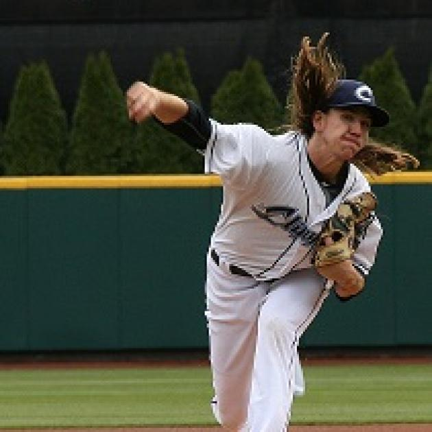 Pitcher throwing a pitch with long hair flying