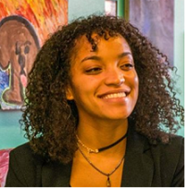 Young black woman smiling with curly shoulder length hair