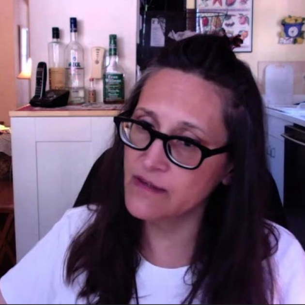 Woman with brown hair and glasses