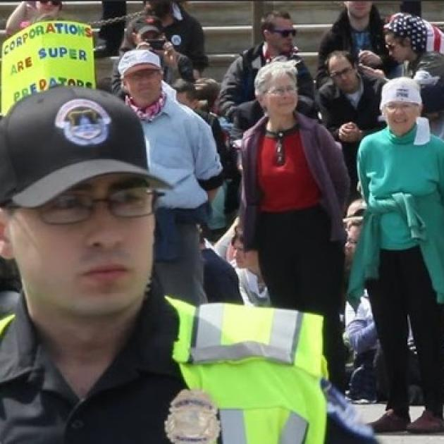 Demonstration with four people in handcuffs