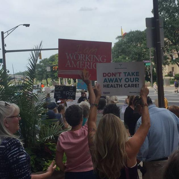 People holding signs about health care