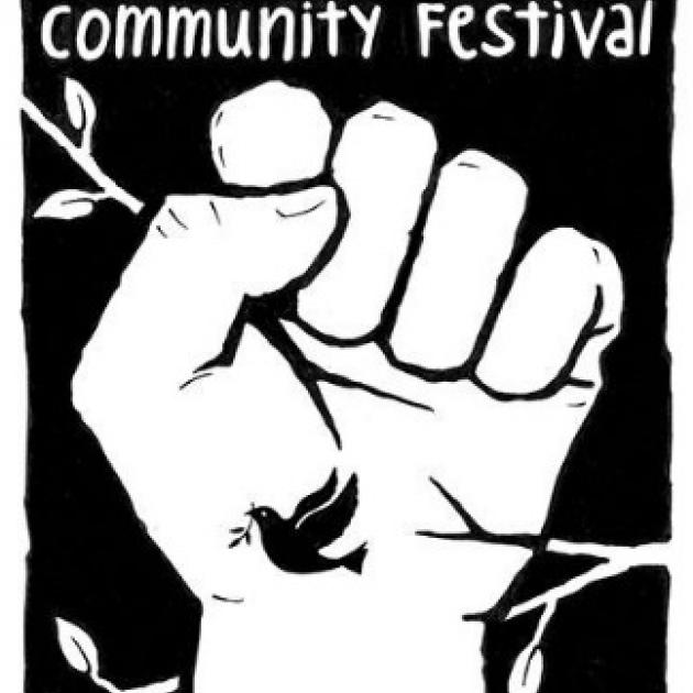 A fist with the words Community Festival