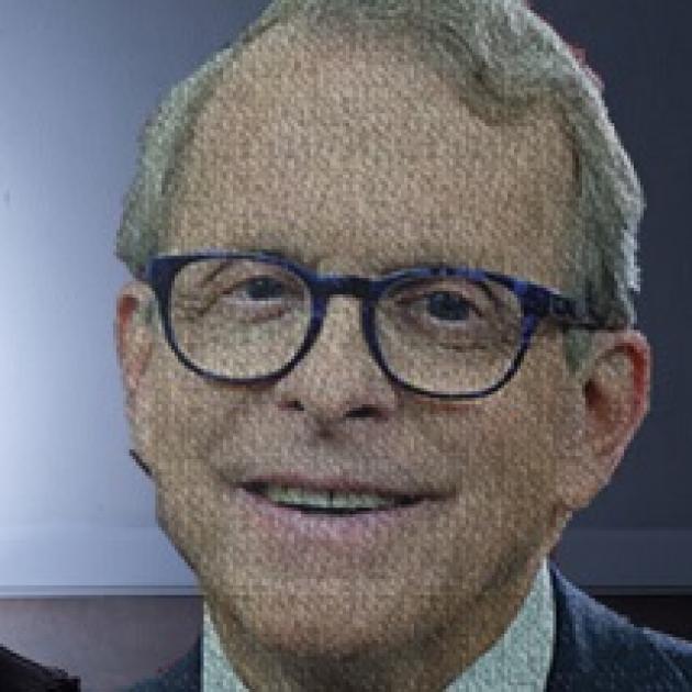 Smiling older white man wearing round black-rimmed glasses