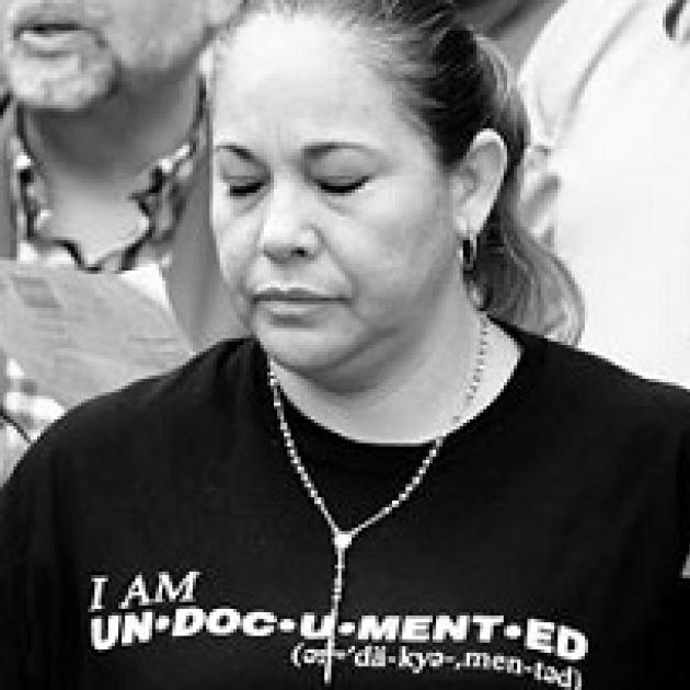 Black and white photo of latina woman with her eyes closed