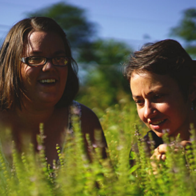 Two young women out in a field
