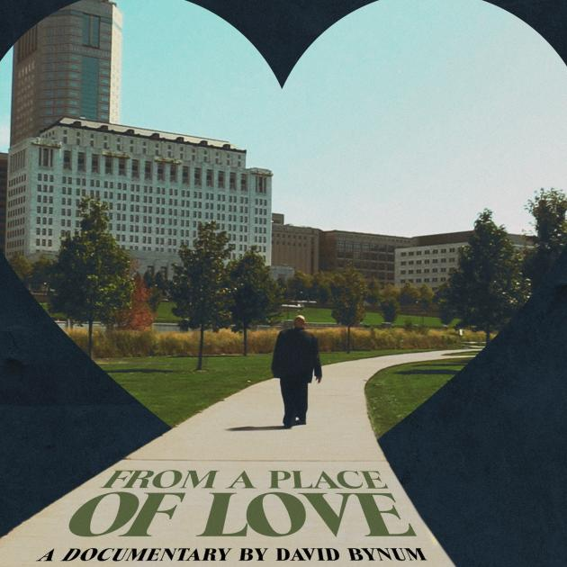 A heart with a man walking on a path and title of movie