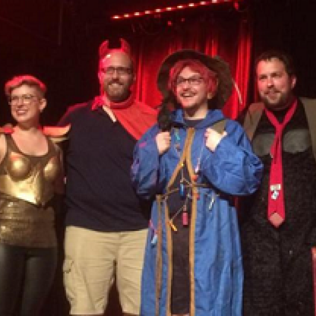 Four people dressed in geeky costumes