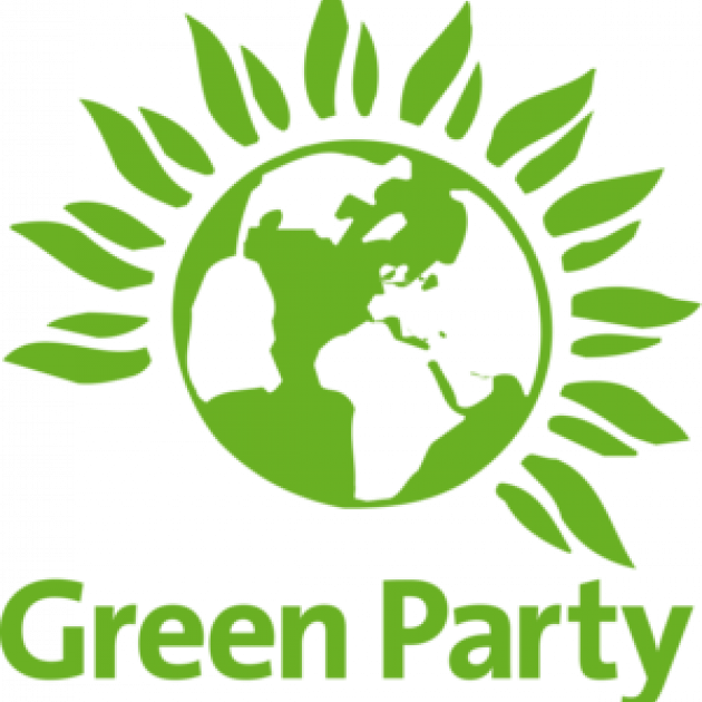 Green earth with leaves growing around it and words Green party