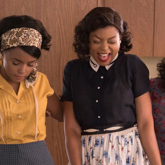 Black women in old fashioned clothes like they are celebrating