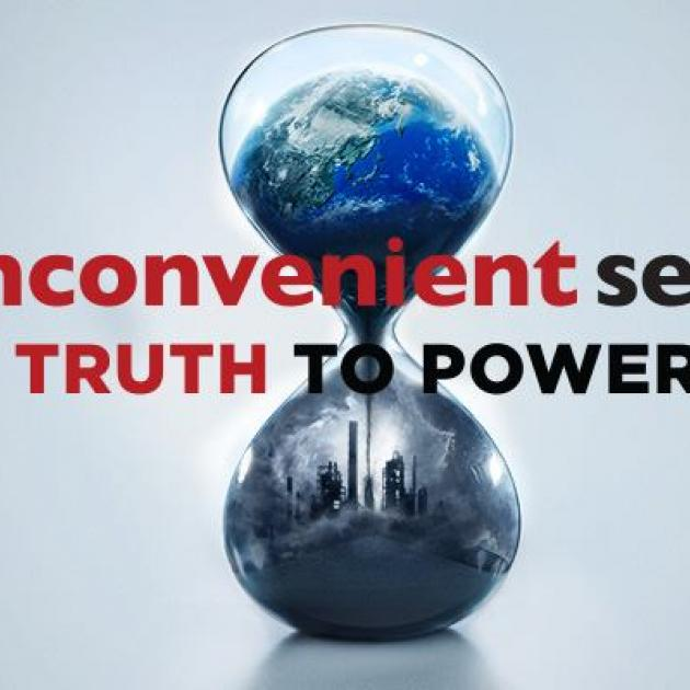 An hourglass with the earth on top and a dark gray skyline on the bottom with the words an inconvenient truth to power