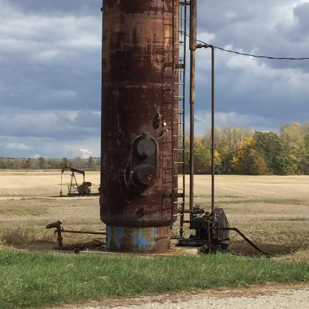 Tall metal structure out in a field - an injection well