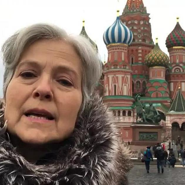 Close up of Jill Stein with famous Moscow building in background