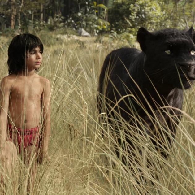 Mowgli (Neel Sethi) and panther friend Bagheera (Ben Kingsley) in The Jungle Book (Disney Enterprises Inc.)