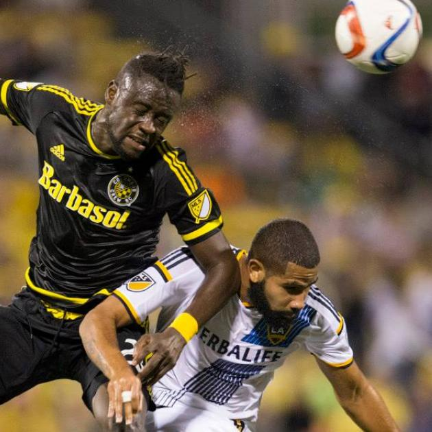 Kei Kamara (left) battles for a header against LA Galaxy defender Leonardo. (Photo courtesy of Crew SC)