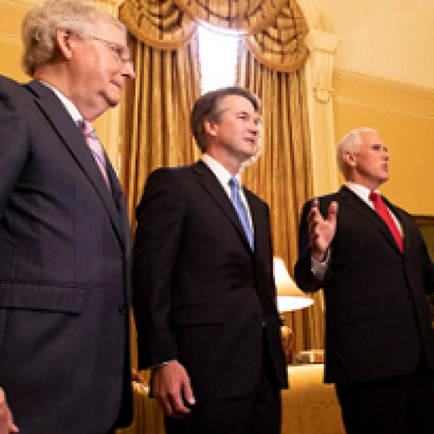 Three older white guys in a room with fancy curtains