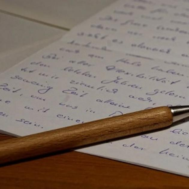 Written letter and a pen