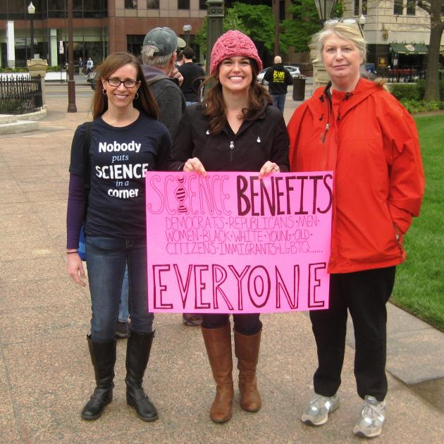 Three women holding sign that says Science Benefits Everyone