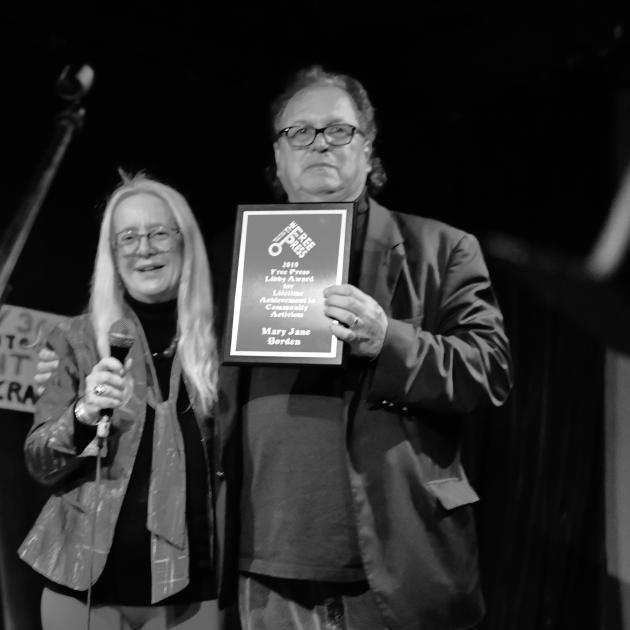 Bob and Mary Jane posing with plaque
