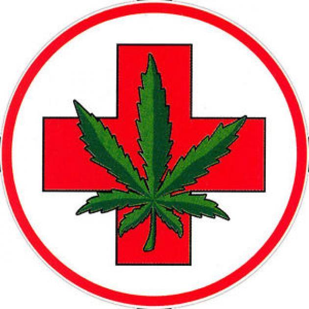 Marijuana leaf on top of a health cross symbol