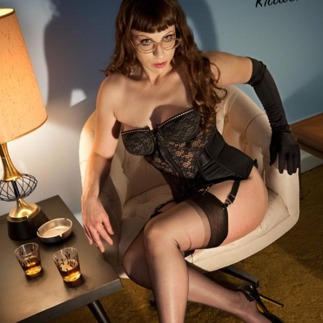 Woman in black lingerie on chair
