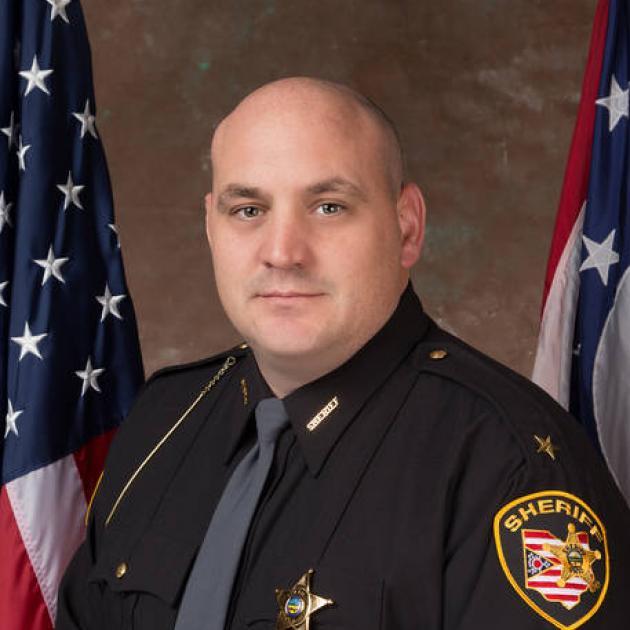Bald white man in a sheriff uniform