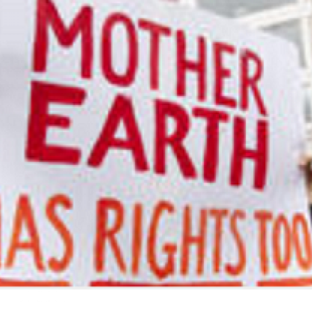 White sign stating Mother Earth Has Rights Too