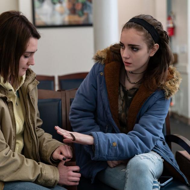 Two women in intense conversation