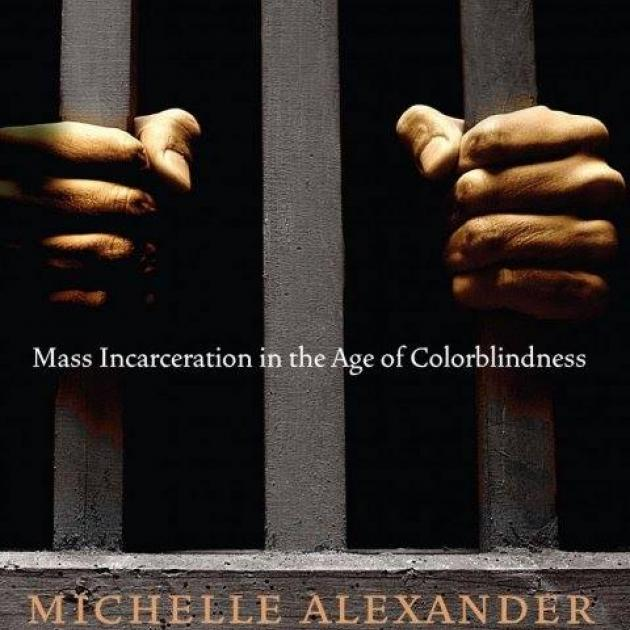 Cover of New Jim Crow book with hands on bars like in a prison