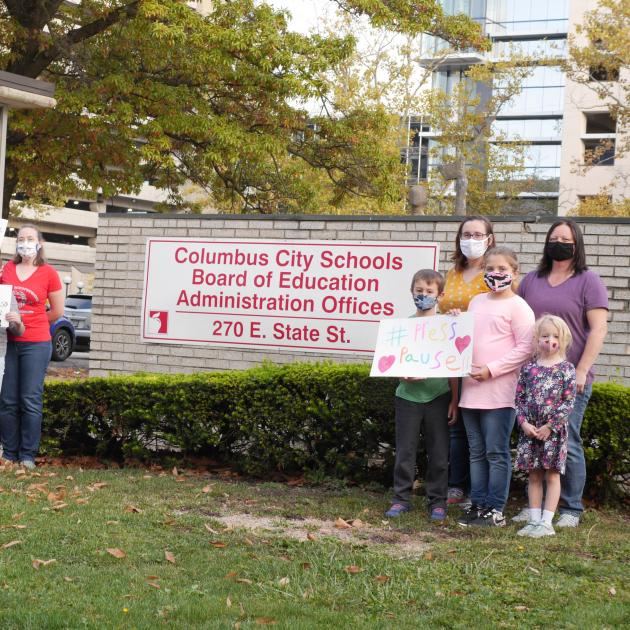 People posing in protest outside Cols City Schools