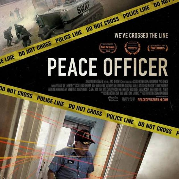 Movie poster with a police officer and yellow tape, words Police Officer