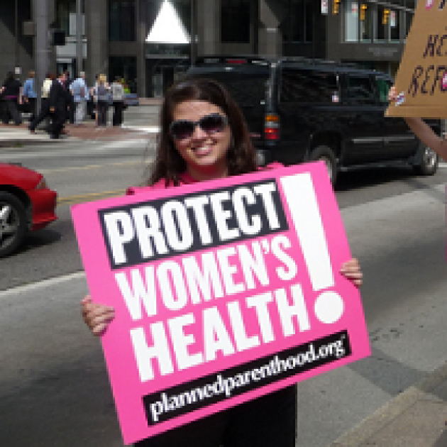 Woman holding sign that says Protect Women's Health