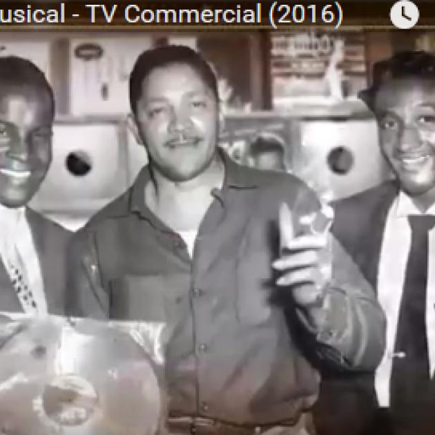 Black and white photo of three guys in recording studio