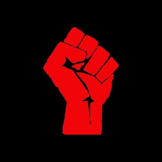 Red fist against black background