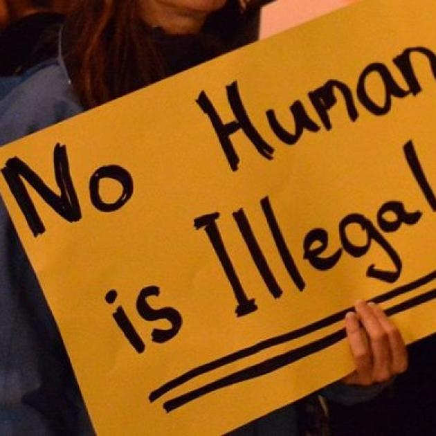 No human being is illegal sign