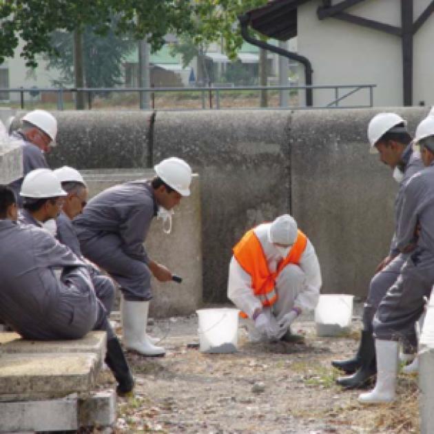 Men in hazard suits working
