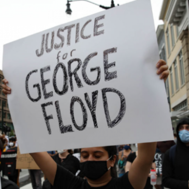 Protester holding sign saying Justice for George Floyd