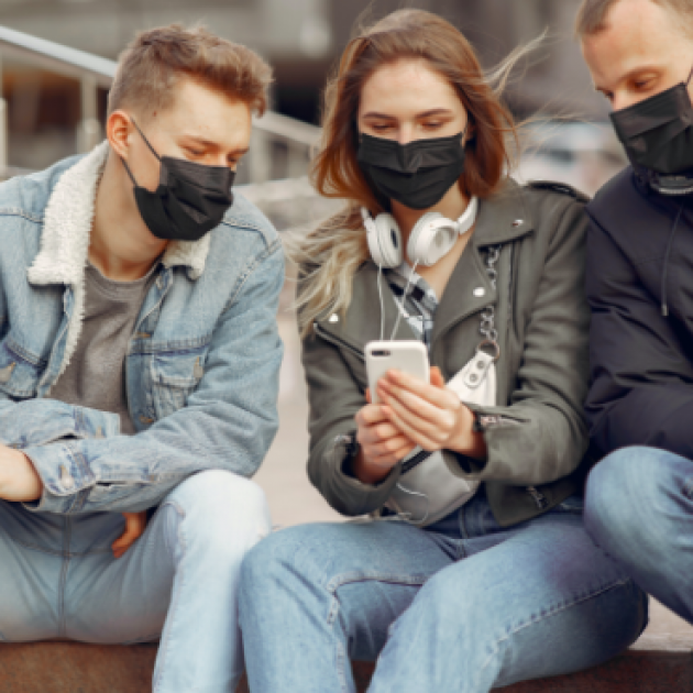 Three young people wearing black face masks