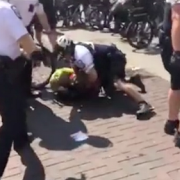 Police throwing man on the ground