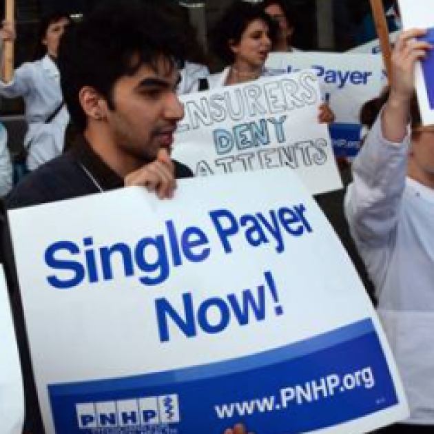 Guy holding Single Payer Now sign