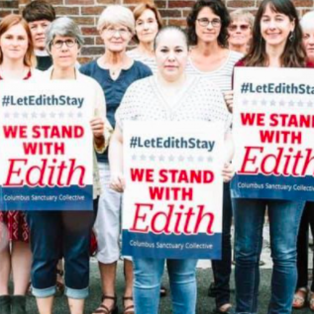 People holding signs that say Solidarity with Edith