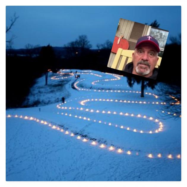 "Serpent Mound and big screen with face of Dave ""Coach"" Daubenmire"