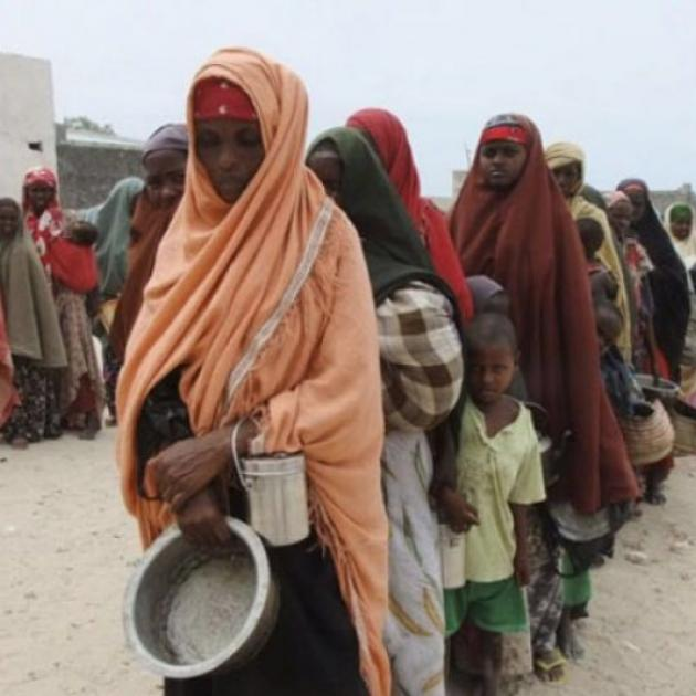 Somalian women in Somalia wearing headresses standing in line waiting for food