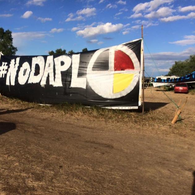 A sign saying #NoDAPL