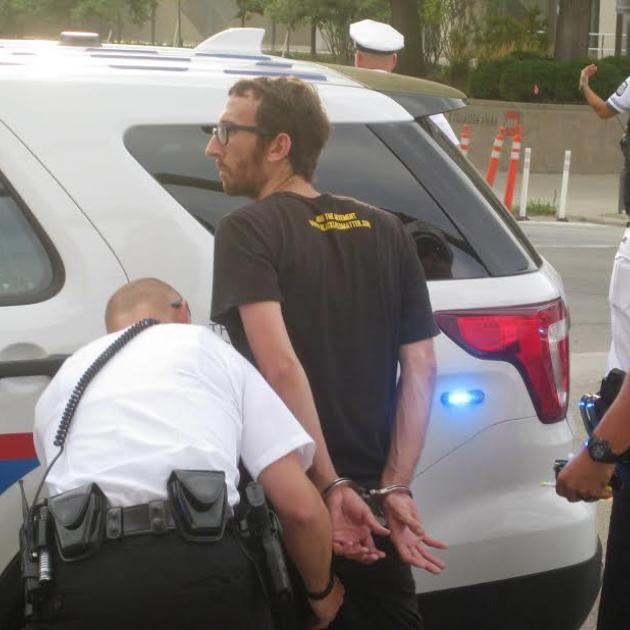 Activist being handcuffed by police