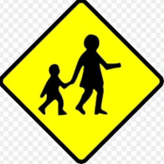 Yellow diamond with black silhouette of woman holding a kids hand walking