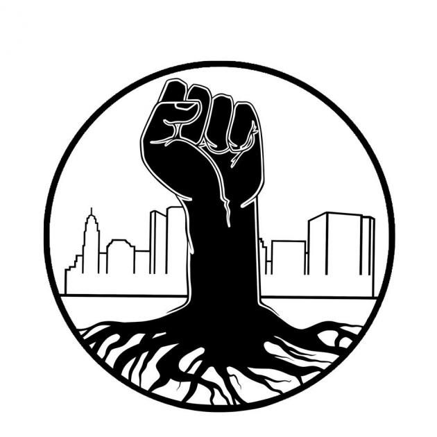 Round black circle with black fist rising as if its a tree from the ground with Columbus skyline in the background