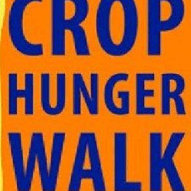Orange background with words CROP HUNGER WALK in blue