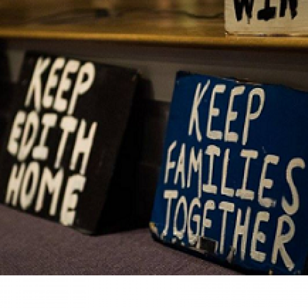 Two stark protest signs one saying Keep Edith Home and one saying  Keep Families Together