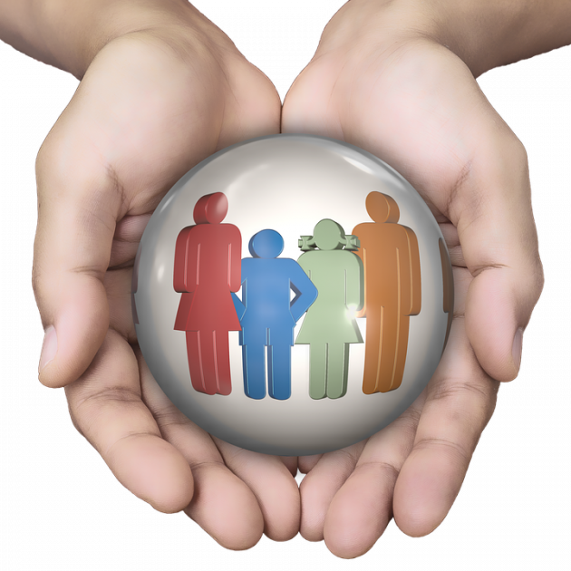 Two hands holding images of a family in a circle