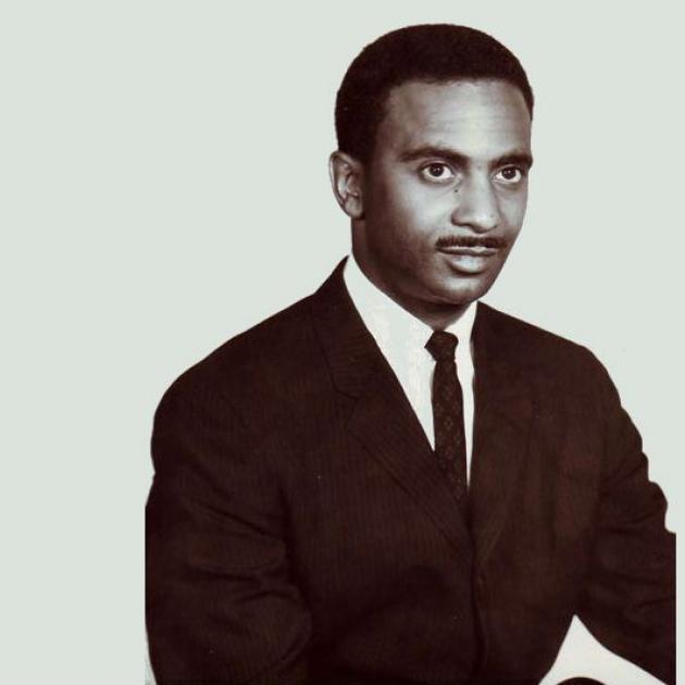 Black and white photo of young black man in a suit